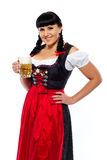 Beautiful brunette woman in Bavarian dressed with glass of beer Stock Photo