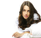Beautiful brunette woman in bed Royalty Free Stock Photos