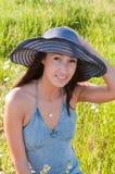 Beautiful brunette woman in big denim hat Royalty Free Stock Image