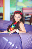 Beautiful brunette woman in bikini sunbathing on couch Royalty Free Stock Images