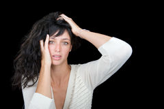 Beautiful brunette woman on black background. Beautiful brunette woman on black background with a surprised expression Royalty Free Stock Photos