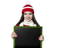 Beautiful brunette woman with black board Stock Photography