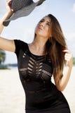 Beautiful brunette woman in black dress bikini Royalty Free Stock Photos