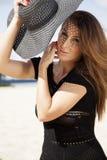 Beautiful brunette woman in black dress bikini Royalty Free Stock Photography