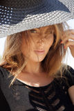 Beautiful brunette woman in black dress bikini Stock Image
