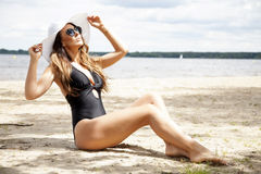 Beautiful brunette woman in black dress bikini Stock Photography