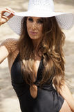 Beautiful brunette woman in black dress bikini Royalty Free Stock Photo