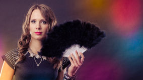 Beautiful brunette woman with black fan in hand Royalty Free Stock Image