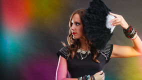 Beautiful brunette woman with black fan in hand Royalty Free Stock Images