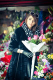 Beautiful brunette woman in black at florist shop Royalty Free Stock Photography
