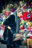 Beautiful brunette woman in black at florist shop Stock Photo