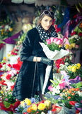 Beautiful brunette woman in black at florist shop Stock Images