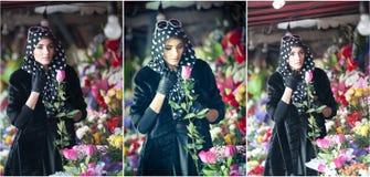 Beautiful brunette woman in black at florist shop Stock Image
