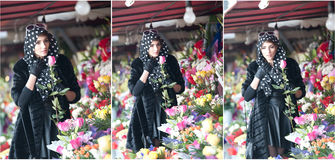 Beautiful brunette woman in black at florist shop Royalty Free Stock Photos