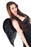 Beautiful brunette woman with black wings Stock Photos
