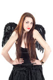 Beautiful brunette woman with black wings Royalty Free Stock Images