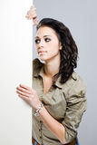 Beautiful brunette woman with blank banner. Royalty Free Stock Image
