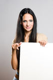Beautiful brunette woman with blank sheet. Stock Photography