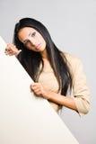 Beautiful brunette woman with blank sheet. Royalty Free Stock Photo