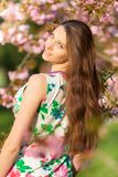 Beautiful  brunette woman in blooming orchard Stock Photo