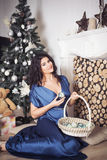 Beautiful brunette woman in blue dress in new year decorated int Stock Photography