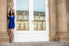 Beautiful brunette woman in blue dress outdoor Stock Photo