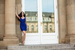 Beautiful brunette woman in blue dress outdoor Stock Photography