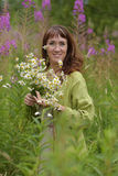 Beautiful brunette woman with a bouquet of daisies Royalty Free Stock Images