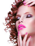 Beautiful brunette woman with bright make up and manicure. Royalty Free Stock Image