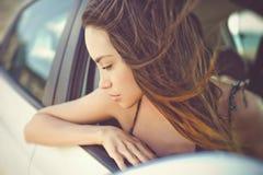 Beautiful brunette woman in car Stock Photo
