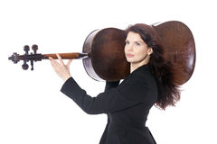 Beautiful brunette woman carries cello on sholder in studio agai Stock Photo