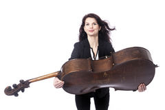Beautiful brunette woman carries cello in studio against white b Stock Image