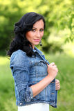 Beautiful brunette woman in casual at the park Royalty Free Stock Images