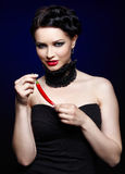 Beautiful brunette woman with cayenne Royalty Free Stock Images