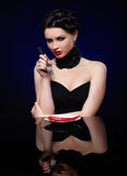 Beautiful brunette woman with chilli pepper Stock Image