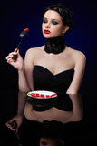 Beautiful brunette woman with chilli pepper Stock Photos