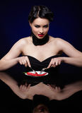 Beautiful brunette woman with chilli pepper Royalty Free Stock Images