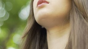 Beautiful brunette woman closed eyes meditation in park, inner peace, calm mind. Stock footage stock video