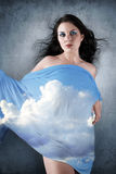 Beautiful brunette woman with clouds Royalty Free Stock Images