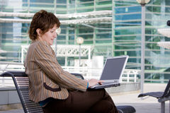Beautiful brunette woman on computer Stock Images