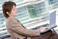 Beautiful brunette woman on computer Royalty Free Stock Image