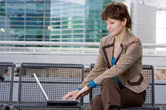Beautiful brunette woman on computer Royalty Free Stock Photography