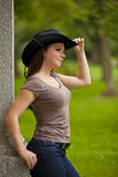 Beautiful brunette woman with cowboy hat Royalty Free Stock Image