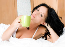 Beautiful brunette woman with a cup of coffee Stock Image
