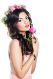 Beautiful Brunette Woman with Curly Hair and Flowers royalty free stock photography