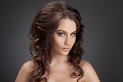 Beautiful Brunette Woman. Curly Long Hair. Stock Images