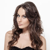 Beautiful Brunette Woman. Curly Long Hair. Royalty Free Stock Images