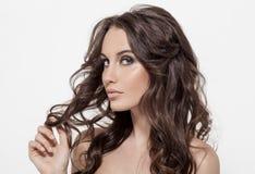 Beautiful Brunette Woman. Curly Long Hair. Stock Image
