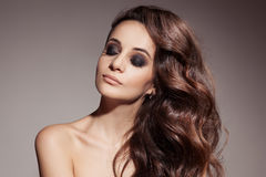 Beautiful Brunette Woman. Curly Long Hair. Stock Photography