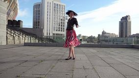 Beautiful brunette woman is dancing in slow motion stock footage